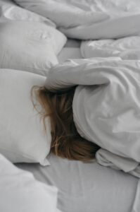 Woman sleeping in a manner that may cause neck pain